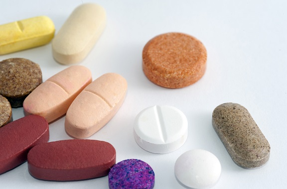 various shaps of pills on a white background